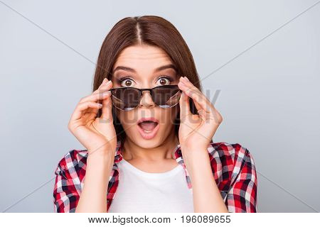 Cute Amazed Brunette Girl Tourist In Shirt, Holding Her Trendy Glasses, She Is Shocked, With Wide Op