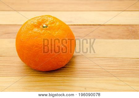 Close up oranges on the wooden table background.