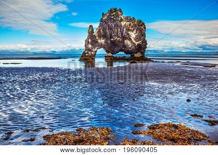 Magic Rock Hvitsercur at sunset. Northern coast of Iceland. Concept of extreme northern tourism