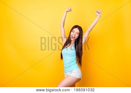 Funky Young Korean Lady Is Jumping Up, Wearing Casual Clothes, Raised Hands. Happiness, Dream, Fun,