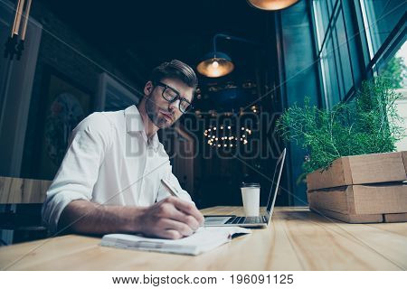 Young Stylish Well Dressed Author Writer Is Working In A Modern Coworking, Writing The Novel, In Gla