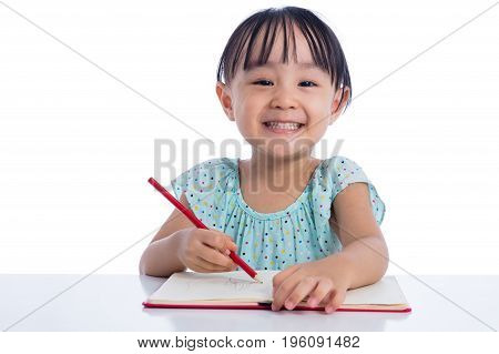 Asian Little Chinese Girl Writing On Exercise Book