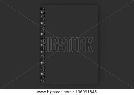 Closed Notebook Spiral Bound On Black Background