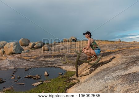 Tourist In Lajedo De Pai Mateus - A Famous Rock Formation In The Caatinga (brazilian Ecoregion) In C