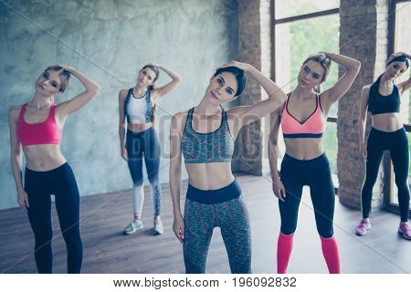 Stretching The Neck Ladies. Five Young Fashionable Sportswomen Are Training, So Bendy And Flexible,