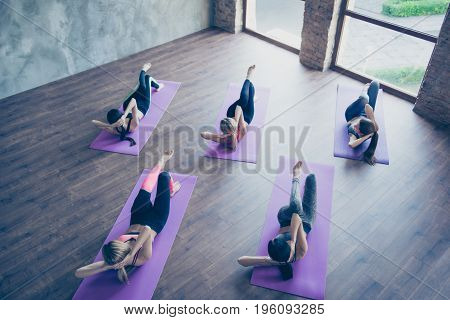 Top Up Of Side Abs Spin Twist Work Out. Five Concentrated Sporty Girls Are Training Their Abs, Weari