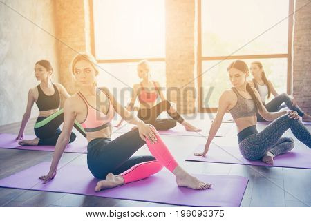 Look Over The Shoulder, Sitting Twisted. Flexibility Exercise. Five Fit Yoga Ladies Are Stretching A