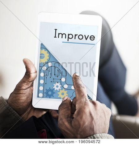Businessman hand connection with digital tablet and improve word