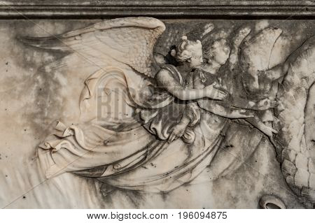 Marble Angel Relief On A Tombstone In The Cemetery Of Menton On The French Riviera