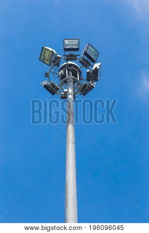 Spot light tower on blue sky background.