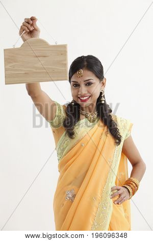 indian woman hanging a woman signage
