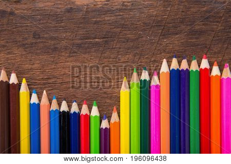 color pencil on wooden background.Crayons. Colored Pencils. colored pencils