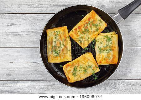 Mozzarella  Greens Stuffed Crepes Wraps On Skillet