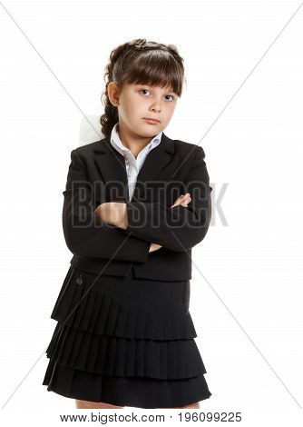 Portrait of serious smart young schoolgirl with crossed hands