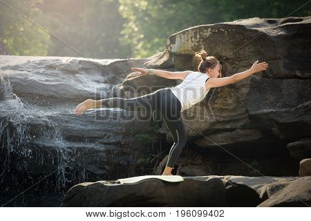 Asian Tall Women Wear White Robes, Do Yoga On Rocks In Forests, And Mountains With Beautiful Waterfa