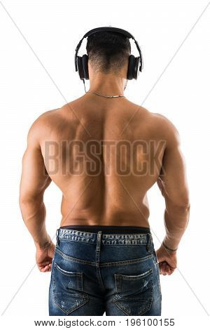Back of shirtless muscular bodybuilder man listening to music with headphones, isolated on white background