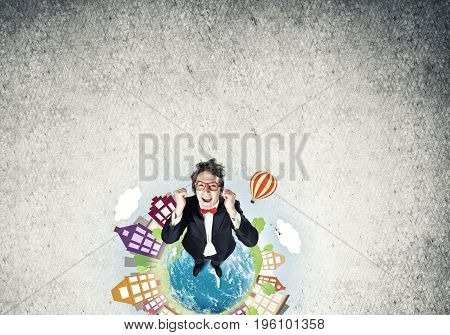 Top view of funny businessman in red glasses celebrating success. Elements of this image are furnished by NASA