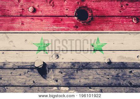 Syrian Flag Painted On A Weathered Wooden Board. Flag Of Syria. Textured Abstract Background