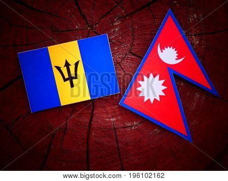 Barbados Flag With Nepali Flag On A Tree Stump Isolated