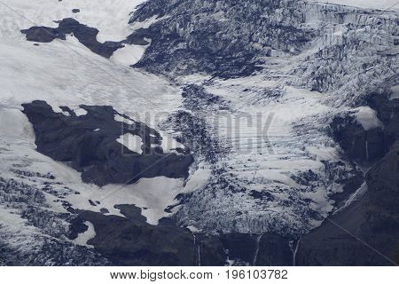 Black White And Blue Glacier With Rock