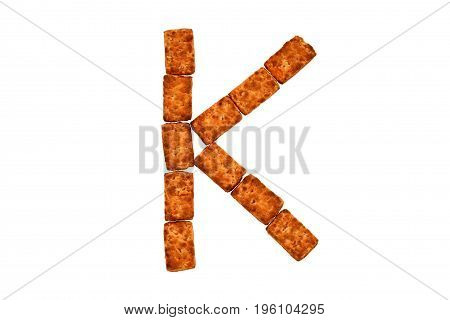 Alphabet made up of cookies on a white isolated background. letter K
