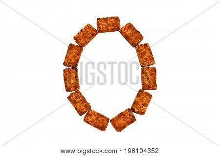 Alphabet made up of cookies on a white isolated background. letter O