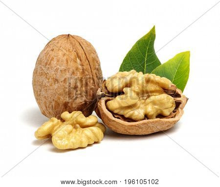 Walnuts with leaves isolated on white