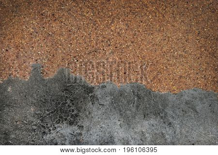 Sandy gravel surface and old cement floor Top view with copy space and for web design or graphic art image