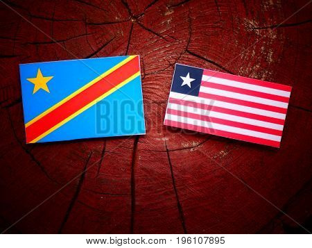 Democratic Republic Of The Congo Flag With Liberian Flag On A Tree Stump Isolated