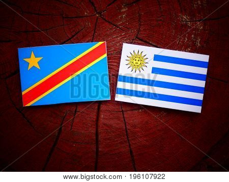 Democratic Republic Of The Congo Flag With Uruguaian Flag On A Tree Stump Isolated