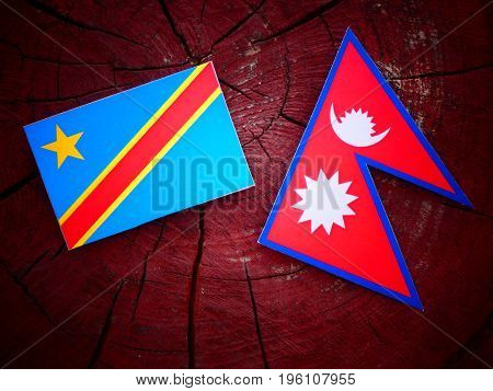 Democratic Republic Of The Congo Flag With Nepali Flag On A Tree Stump Isolated