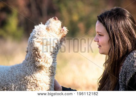 Beautiful young girl and her singing dog