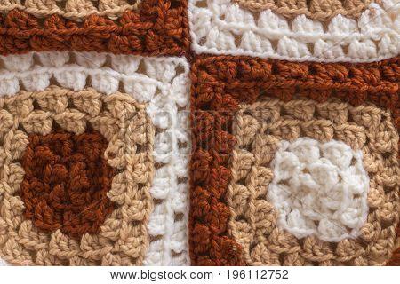 Macro background pattern of woolen thread brown crocheted
