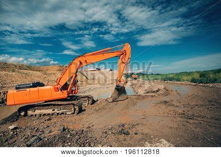Industrial Excavator Working On Highway Construction Site. Details Of Excavator Digging In Water And