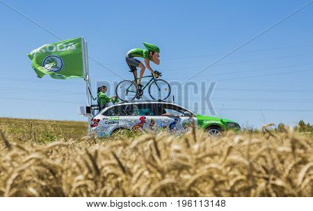 Saint-Quentin-Fallavier France - July 16 2016: The sprinter mascot of Skoda during the passing of Publicity Caravan in a wheat plain in the stage 14 of Tour de France 2016.