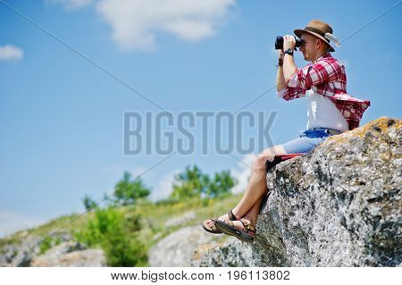 Portrait Of A Handsome Man In Checkered Shirt Posing With Binoculars.