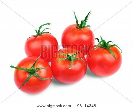 A few colorful fresh tomatoes isolated over the white background. Five perfect round red tomatoes with saturated green leaves. Nutritious vegetables for tasteful summer salads.