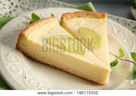Plate with delicious slices of cheesecake, closeup