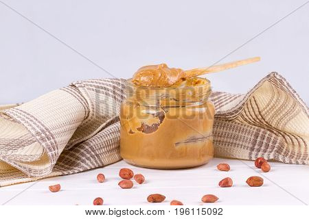 an open jar of peanut butter with spoon
