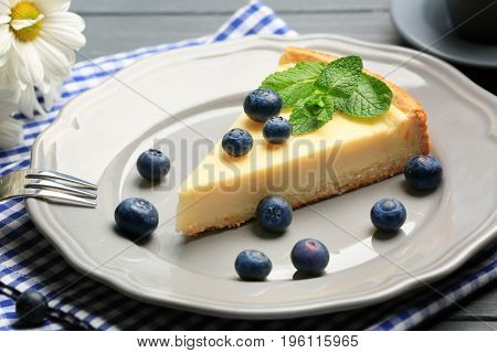 Plate with delicious cheesecake, berries and fork, closeup