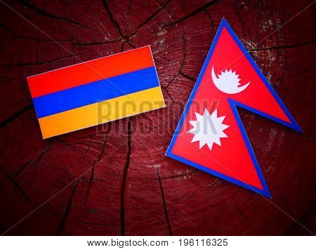 Armenian Flag With Nepali Flag On A Tree Stump Isolated
