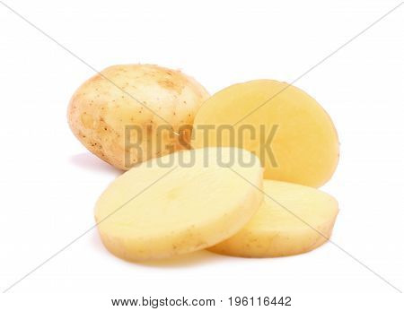 Fresh tasty potatoes cut into perfect round slices. Uncooked potato tubers isolated over the bright white background. A whole potato root and a half of a tuber. Nutritious vegetables.