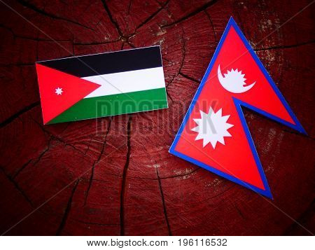 Jordanian Flag With Nepali Flag On A Tree Stump Isolated