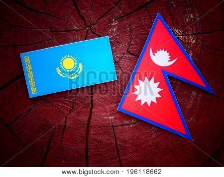 Kazakhstan Flag With Nepali Flag On A Tree Stump Isolated