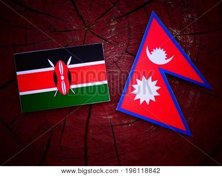 Kenyan Flag With Nepali Flag On A Tree Stump Isolated