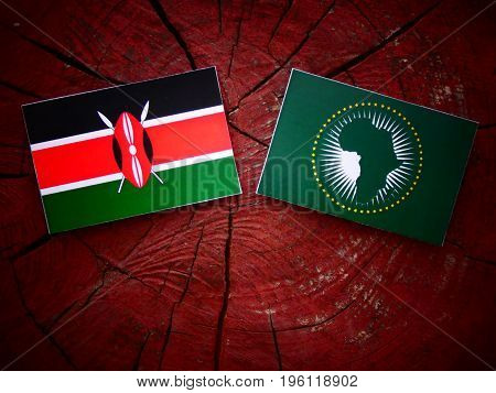 Kenyan Flag With African Union Flag On A Tree Stump Isolated