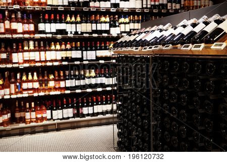 Shelves with various bottles of wine in store