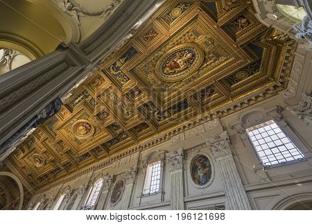 The ceiling with gold details in Basilica di San Giovanni in Laterano (St. John Lateran basilica). Italy Rome June 2017