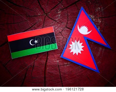Libyan Flag With Nepali Flag On A Tree Stump Isolated
