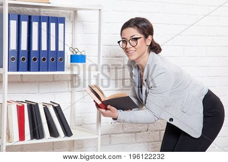 business girl sits at a computer in the Office paper folders Secretary